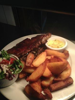 Picture of Sirloin Steak (served with chips salad. fried onion & mushrooms)